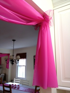 Use $1 plastic tablecloths to decorate doorways and windows for parties